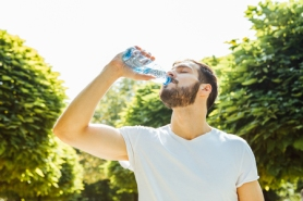 46452025 - close up of a man drinking water from a bottle outside