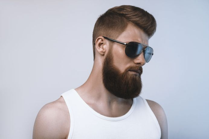 43765749 - bearded man wearing sunglasses. studio shot on white background
