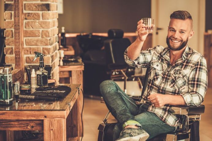 42273611 - happy client in barber shop will glass of whiskey