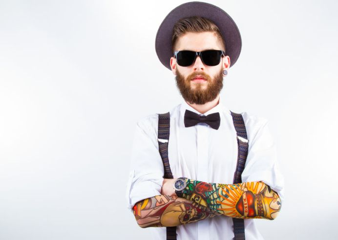 32748363 - young hipster man wearing  hat, suspenders,  bow-tie and a funny tattoo-sleeve