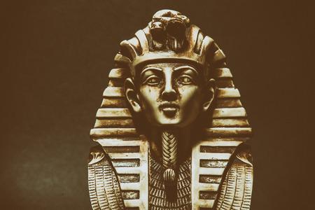 54570346 - stone pharaoh tutankhamen mask on dark background