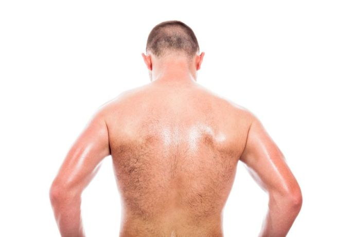 19386897 - rear view of young shirtless man, isolated on white background
